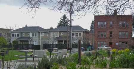 Also built in 2005, these 8 townhouses overlook Seven Hills Park.  Because they are built to an appropriate scale, they do not cast shadows onto the populark park that has a sunny p-patch, barbecue pits and picnic benches, and a large sunny lawn.