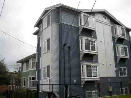 This oversized structure was recently built at 13th Ave. East and East John St, next to a classic Seattle Box.  If it had been built in 2010 before the height limit change, it would have been 1 story smaller, allowing its neighbor access to sun, air, and sky.  We are rapidly losing the human scale of Seattle's lowrise neighborhoods!