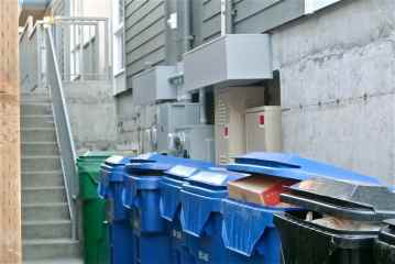 This picture taken on Jan. 4, 2014 shows that a row of waste bins now completely blocks access to the building's   electrical shutoff valve. Fire safety rules typically require unimpeded access to the shutoff valve.